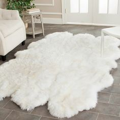 Bedroom - Handmade sheepskin shag rug. Sheepskin in White, love, adds texture and softness, perfect luxurious touch