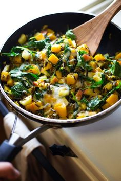 Apples, squash, sauteed onions, wild rice, and baby kale come together with melted cheese for a yummy Wild Rice Skillet. Perfect for fall!