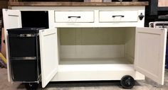 Farmhouse Industrial Kitchen Island with handy roll out Trash Container Industrial Kitchen Island, Farmhouse Kitchen Island, Industrial Farmhouse, Kitchen Islands, Kitchen Island On Wheels With Seating, Rolling Kitchen Island, Trash Containers, Lake Cabins, Rustic Furniture