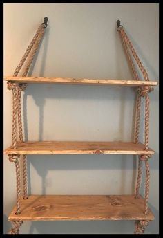 Beautiful large hanging rope and wood planks shelves. Boards are hand-made - Beautiful large hanging rope and wood planks shelves. Boards are stressed by hand … -