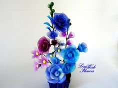 Items similar to Beautifully rose bouquet are the different colors that's blue and purple. Handcraft nylon fabric flower and leaves. Floral arrangement on Etsy Nylon Flowers, Fabric Flowers, Wedding Napkins, Rose Bouquet, Flower Pots, Different Colors, Floral Arrangements, Purple, Sled Dogs