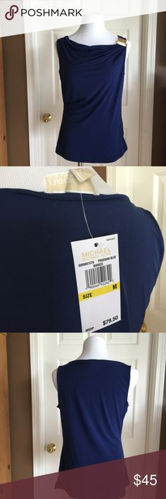 """Michael Kors Blue Sleeveless Top Neck Buckle Sz M This listing is for a NWT Michael Kors Blue Sleeveless Top with Neck Buckle In Size Medium.  Color is called """"Prussian Blue"""" - just beautiful!  *fabrics - 94% polyester, 6% spandex *wash instructions - machine wash cold, lay flat to dry *measurements - 36"""" chest with tons of stretch, 25"""" length.  Professional picture shown to better depict gold belt at neck.  Color is as depicted in other pictures.  *non-smoking home.  Top will be delivered…"""