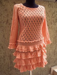Crochet women dress in light orange colour good for everyday and official moments. LOVE the color and the ruffles on this!