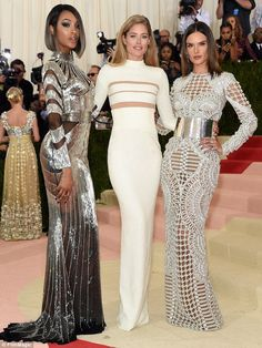 Technology trio: The model joined fellow catwalk queens Jourdan Dunn (L) and Alessandra Ambrosio (R) in embracing the Manus x Machina: Fashion In An Age Of Technology theme