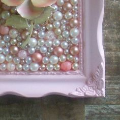 Mosaic with repurposed pearls and vintage enamelware brooch. Vintage pink and cream. Shabby chic decor. Ornate wood frame.