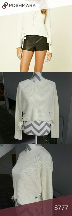 "Sassy cream sweater with lace up detail on side Brand new. Boutique item. New with tags. Price is firm.  SASSY cream knitted sweater featuring lace up detail on sides. Pair with your favorite jeans and boots and off you go. Comfy and cozy!  Material 100% acrylic Size large Length 19""  BUST 19"" across  Made in Bangladesh    Sweaters"