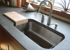 Slate colored concrete countertop with a stainless steel undermount sink. #Concrete #Countertops -Trueform Concrete Custom Work
