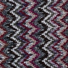 From Italy, a thick wool knit in a classic flamestitch pattern. Chunky yarns in colors of ivory, olive, maroon, purple and gray. Perfect for big sweaters, capes and ponchos.