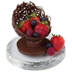 CHOCOLATE FILIGREE BOWL Add a continental touch to your dessert table with a candy filigree creation Perfect for Valentines day or any special occasion! Chocolate Bowls, Chocolate Drip, Chocolate Desserts, Chocolate Flowers, Homemade Chocolate, Chocolate Baskets, Fancy Desserts, Delicious Desserts, Dessert Recipes
