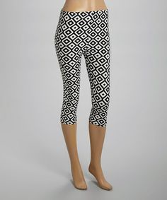 great Capris. I will wear them with a great black and white poka a dotta top, or another white lace top. both will be very cute, and comfortable. I will top the outfit off, with bright colored matching accessories. What a great find !!!