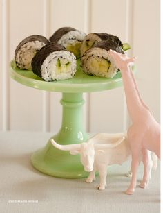 {painted} plastic animals as table decor. I would have sweets on the cake stand though :)