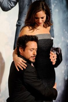"Susan Downey Photos - Actor Robert Downey Jr and wife producer Susan Downey attends ""Sherlock Holmes"" premiere at Kinepolis cinema on January 2010 in Madrid, Spain. Susan Downey, Robert Downey Jr., Robert Downey Jr Family, Famous Couples, Famous Men, Famous People, Bob Marley, Welcome Baby Boys, How To Pose"