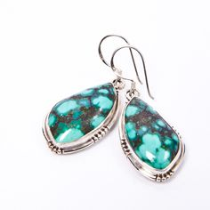 Let your inner cowgirl shine! Wear with a crisp white blouse and pair with a ponytail to let these gorgeous handcrafted turquoise earrings make you the centre of attention! Hand-cut and shaped raw turquoise stones set in .925 sterling silver.