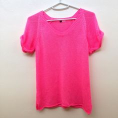 Bright pink flowy knit pullover/shirt Bright pink knit flowy pullover/shirt. Size S. Only worn once, in like new condition! Tags cut out due to discomfort, but this is a size S from H&M. H&M Tops Tees - Short Sleeve