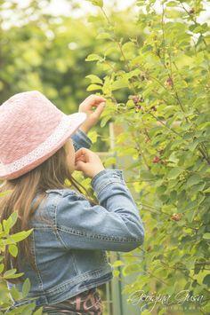 Little girl eating blueberries