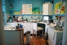 Donna Downey's craft studio. I love this. I love her paintings all over the place. I love the colors. I love the creative mess. :)
