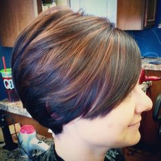 Short womens haircut. Chocolate dark brown hair color with copper highlights