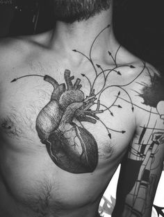 Anatomical heart tattoo. This is why I'm enthralled by ink as a means of artistic expression.