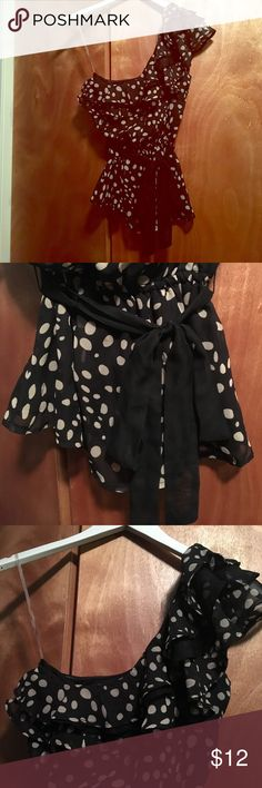 One shoulder ruffled neck poke-a-dot top One shoulder ruffled neck poke-a-dot top. Elastic at waist. Only worn a couple of times. Size is a small but fits more as an extra small. Super cute with black pants or jeans mandee Tops Tank Tops