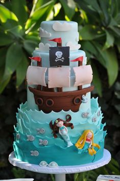 Pirate & Mermaid Cake -- adorable! Perfect for if you're celebrating a boy and girl birthday together