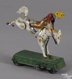 Lehmann hand painted tin wind-up Bucking Bronco, 6 1/4'' l. - Price Estimate: $200 - $300