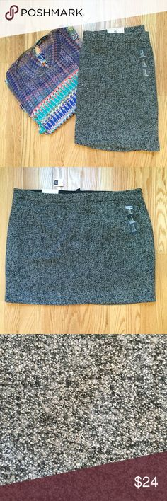 """GAP Mini Skirt This wool blend mini skirt by GAP is NWT. Featuring a side zipper, the skirt is fully lined and the perfect staple piece for your closet. Fabric: 49% poly, 32% rayon, 19% wool. Length 17.5"""" GAP Skirts Mini"""