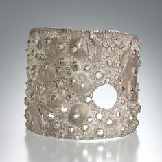 Darcy Miro....One-of-a-kind wide sterling silver cuff with one diamond.