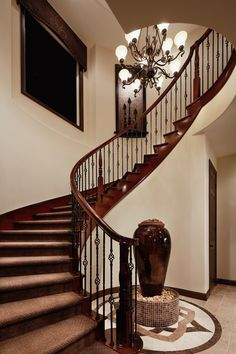 Toll Brothers - The La Spezia is equipped with a stunning curved staircase that is sure to impress all your guests.