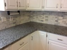 Caledonia Granite With Backsplash Tiles. White Kitchen CabinetsKitchen ...