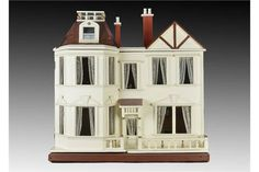 A G & J Lines dolls' house No.33 1909-10, with cream painted façade, two-storey bay window to one