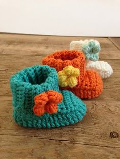 SPRING FLOWER BABY BOOTIES: You will need:   Crochet Hook 3.5mm,  Berroco Comfort DK in turquoise and Orange,  Tapestry Needle. (Tute/Pattern)