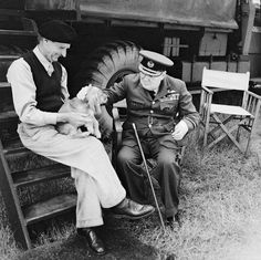 Prime Minister Winston Churchill and General Sir Bernard Montgomery & his dog (named Rommel) in Normandy at Montgomery's caravan at his headquarters at Chateau Creully, 7 August 1944