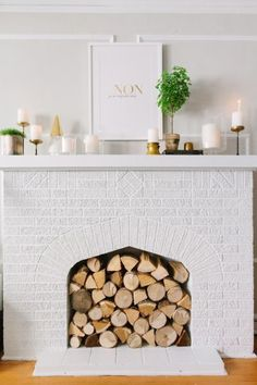 Lampert Lampert Moss Chicago Home Tour // living room // fireplace // exposed brick // white // Sarah & Bendrix print // mantle styling // photography by Stoffer Photography Decor, Brick Fireplace, Home Living Room, Chicago Apartment, Living Room With Fireplace, Fireplace Design, Home Decor, Unused Fireplace, Painted Brick