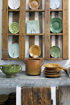 Having a good eye is not about having endless amounts of money.  This picture illustrates the point.  Someone has carefully collected together a wonderful grouping of pottery displayed on an old pallet - absolutely stunning.