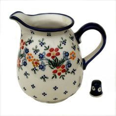 Jug normal 1 litre in MS02 U1 - Wild Flowers, one of our newer modern Designs, with a fresh take on the red flower which has been taken from our Signature DPCS Design.   All our Polish Pottery is Oven to Tableware. Ovenproof, Microwave & Dishwasher Safe as well as suitable for Freezer, Aga & Rayburn.