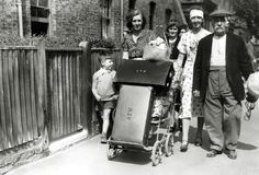 Circa 1940, London: A family, homeless and injured, having lost their home to German bombs, but still seemingly cheerful, pictured in south west London (Photo by Popperfoto/Getty Images)
