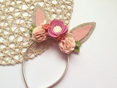 These beautifully sweet bunny ears are made with oatmeal colored felt and accented with peach, blush and mauve flowers. Ears sit on top of your choice of a 10 mm satin head band, soft nylon band or elastic, perfect for the tiniest little ones. Sizing Options for elastic: 0-3 months