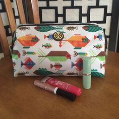 Tory Burch Nylon large molded case Cosmetic case with fish patterns. Zips closed and has an inside pocket. Metal frame and water resistant nylon. 5.5 X 9.0 X 5.5. Sold out online. Perfect condition. Looks new. Tory Burch Bags Cosmetic Bags & Cases