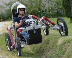 SWINCAR - A tilting spider car. Each wheel has its own electric hub motor and is independently suspended on a spider-like limb. Go Kart, E Quad, E Motor, Terrain Vehicle, Jeep Willys, Pedal Cars, Car Makes, How To Make Light, Electric Cars