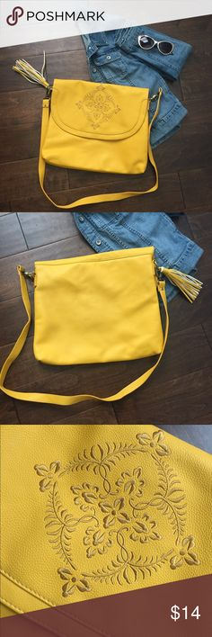 Yellow Messenger Bag by Mossimo Cute Messenger Bag from Target.  Features cute embroidered design on the outside flap.  Fringe tassel accent.  Detachable strap.  Inside is not big enough for my MacBook Pro, but it does fit a tablet or smaller laptop, envelopes, or a notebook. Mossimo Supply Co. Bags Crossbody Bags