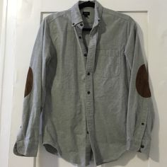 J. Crew Flannel Sz S In great condition. Grey thick flannel shirt with brown suede elbow patches. Perfect for Spring or Fall. J. Crew Tops Button Down Shirts