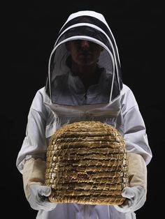 "Great page with lots of info including how to make a traditional straw skep (beehive).  Not legal for keeping bees in LA, but you can make one for decorative use (they make great ""hides"" to cover up water faucets and the like)."