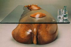 The hippo itself is carved from solid Limewood and features a 10mm toughened glass top. Description from sableandox.co.uk. I searched for this on bing.com/images