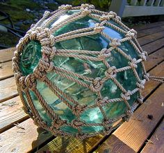Neat idea for some light fixtures...... Green Glass Fishing Vintage Float 12 INCH Net by lightinawormhole.