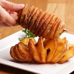 Tornado Potatoes Serves: 2 INGREDIENTS 2 medium white potatoes 4 tablespoons butter, melted 1 cup parmesan cheese, grated ½ teaspoon black pepper 1 tablespoon garlic powder 1 tablespoon paprika 1 teaspoon salt Parsley, chopped (for garnish) PREPARATION Pr