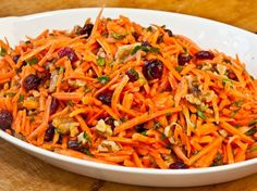 With dried cranberries, toasted walnuts and a bright-tasting citrus vinaigrette, this carrot slaw is delightfully crunchy and sweet. It's perfect for a light lunch or as a healthy side to sandwiches or burgers.