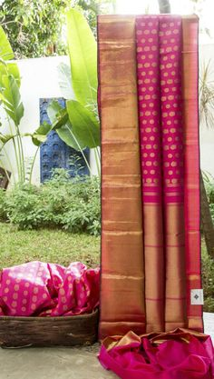 This kanchivaram silk is in hot pink with gold zari brocade work displaying traditional kanchivaram motifs all over. The border is in plain gold zari and the pallu has gold zari work over hot pink ...