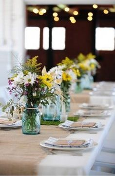 Baby's breath and snapdragon centerpieces in pink, coral and white in blue mason jars. Description from pinterest.com. I searched for this on bing.com/images