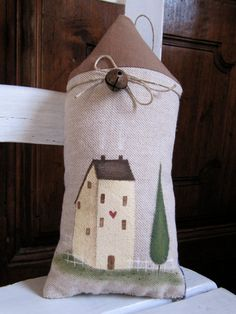 Country ornament: stuffed fabric hand painted house. $12,00, via Etsy.
