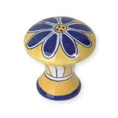 "Atlas Homewares 2A100 1-1/2 Inch Diameter Daisy Cabinet Knob from the Ceramic Collection What better way to brighten each day with this colorful and fun Blue Daisy Knob from the Atlas Provence Collection? The rich yellow knob features a deep blue painted daisy. The graceful waist of this knob is also painted with a white and yellow striped design, adding that much more character. Each knob is hand-painted and made of a ceramic material. Diameter: 1-1/2""Projection: 2""Designed for use with…"